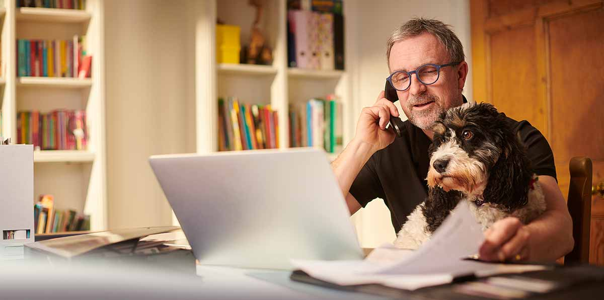 Person on the phone with Renew Financial with dog in lap